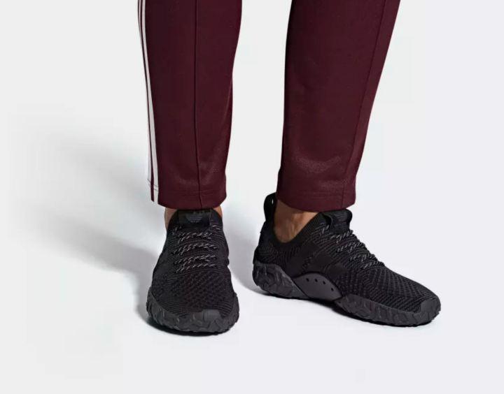 adidas f22 primeknit triple black on foot