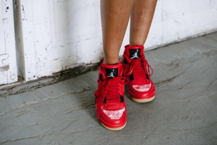 f6876a4ead54 The Women s Air Jordan 4  Fire Red  Releases on Single s Day