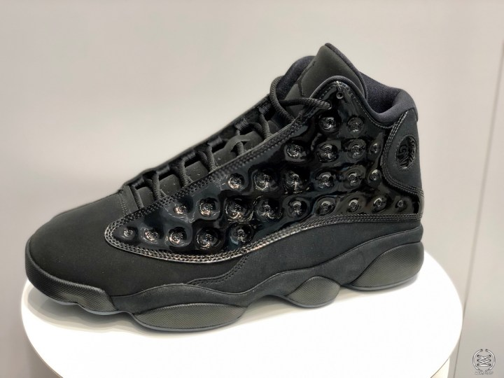 d155d24e94efd The Air Jordan 13 Retro  Cap  n Gown  features a mix of suede and patent  leather. The hologram logo was removed and replaced with a metal version of  the ...