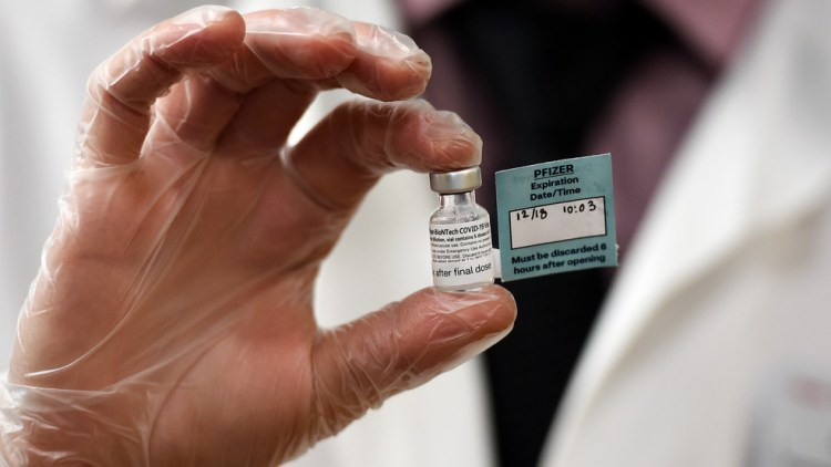 A vial of the Pfizer vaccine used at The Reservoir nursing facility, is shown, Friday, Dec. 18, 2020, in West Hartford, Conn. (AP Photo/Stephen Dunn,Pool)