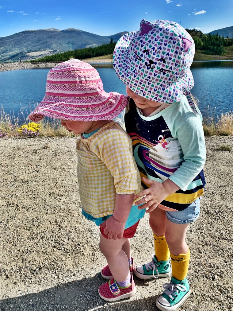 sisters hugging at Old Dillon Reservoir Trail