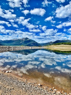 mountain and cloud reflections at Old Dillon Reservoir Trail