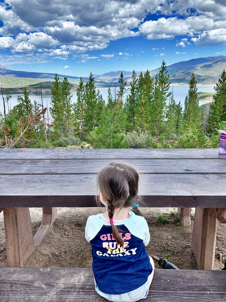 little girl looking out over Sapphire Point Overlook