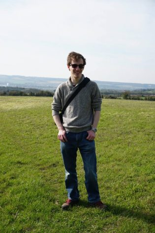 William Easdown standing in a field on a sunny day
