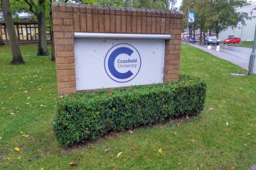 Cranfield University's logo on a sign