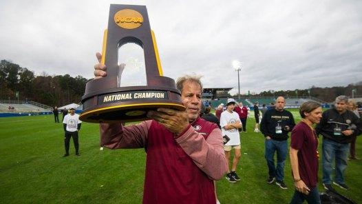 Florida State Mark Krikorian lifts the championship trophy