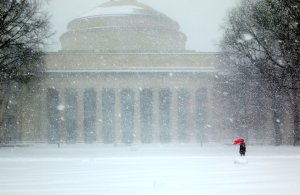 MIT Killian Court in a blizzard with a person holding an umbrella