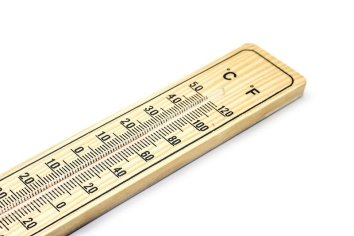 A wooden thermometer showing Fahrenheit and Celsius