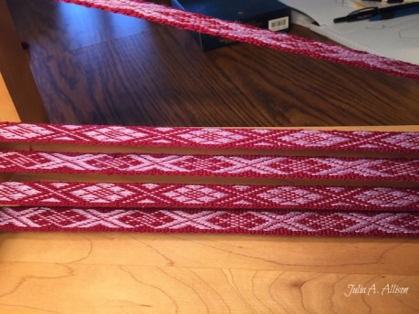 The finished band before taking off the loom.