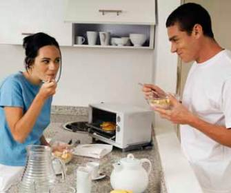 Couple enjoying food from toaster oven