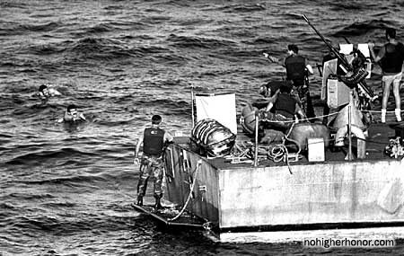 Sailors on a U.S. Navy Mark 3 patrol boat prepare to pull Iranians from the water during Operation Prime Chance, a part of the U.S. Navy's Operation Earnest Will.