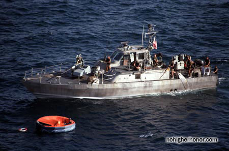 Mark 3 patrol boat next to a life raft during Operation Prime Chance, a part of the U.S. Navy's Operation Earnest Will.