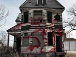 Ghost town: A vacant and blighted home, covered with red spray paint, sits alone in an east side neighborhood once full of homes in Detroit