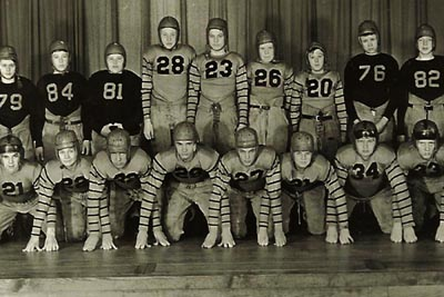 High School football team. Notice the padding and helmets.