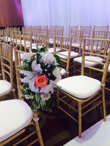 gold chairs with flowers