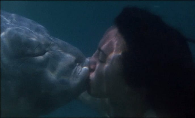 Anna has an underwater kiss with a fish
