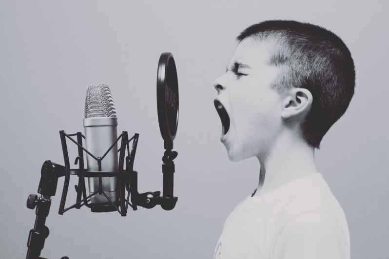 Child Practising Vocals on Mic