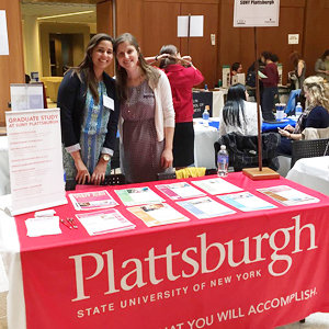 Photo of SUNY Plattsburgh Graduate Admissions staff at Grad Job Fair.