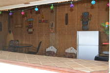 TIKI BAR equipped with refrigerator, microwave, utility sink, and extra seating. Great place to serve up a drink or prepare your outdoor BBQ.