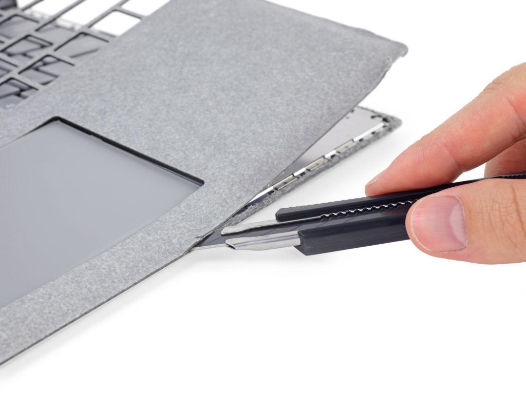 ifixit surface lap alcantara La Microsoft Surface Laptop es calificada de irreparable
