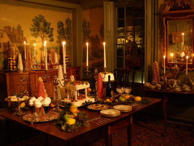 Candle lit table decorated for Christmas at Webb-Deane-Stevens Museum