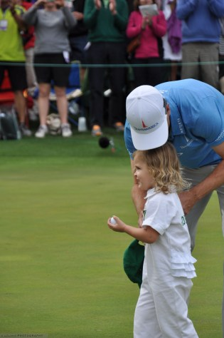 Zach Johnson's daughter pulls the ball from the cup