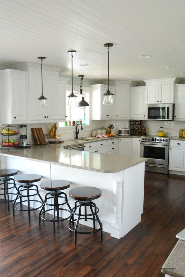 The Idea Room reveals a stunning kitchen remodel complete with updated pendant lights and smudge-proof Fri