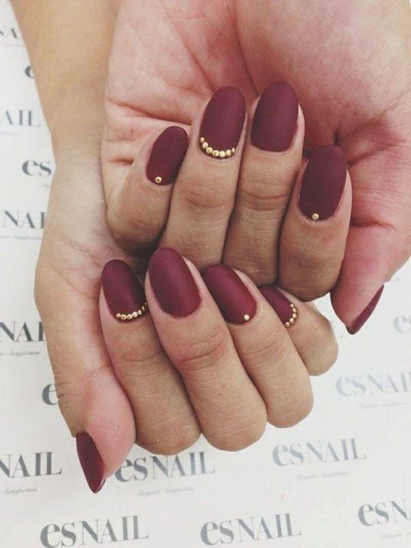Marsala wedding nails with gold accents | Super Stylish Wedding Manicure Ideas via @Weddingbells
