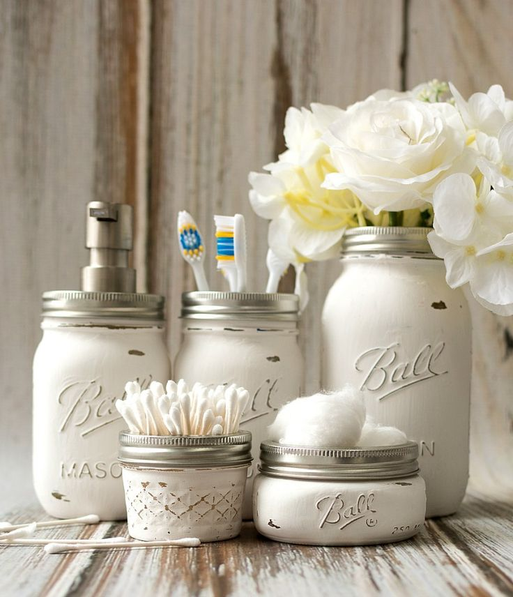 A DIY tutorial on how to make your own mason jar bathroom storage, accessory set.Includes how to paint and