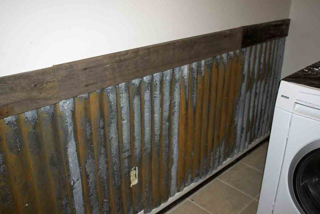 Rusty corrugated / galvanized tin gets new life as board and baton.  I originally planned on using wood, b