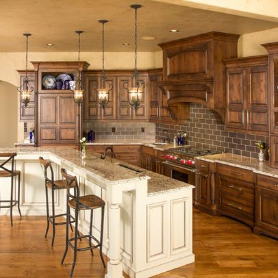 Rustic Two Toned Cabinets Design. I like the open storage above the cabinets with the blue plates! Nice va