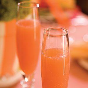 Blushing Mimosas: Orange Juice, Pineapple Juice, Champagne with a splash of grenadine :)