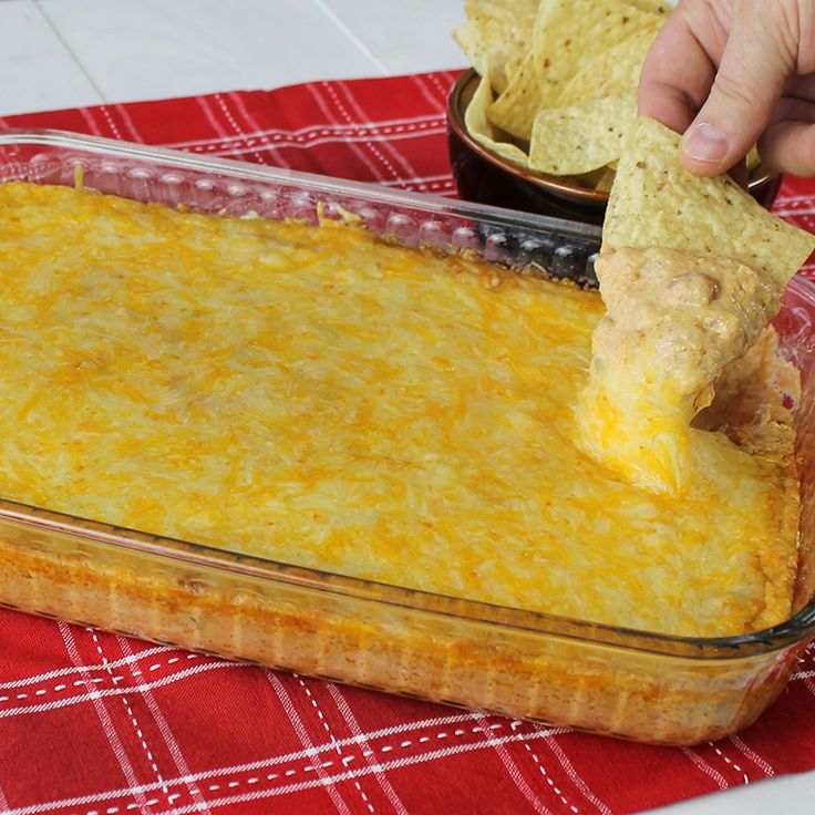 Stop the search! Texas Trash Dip is the ultimate ooey, gooey, cheesy bean dip that's perfect as a ga