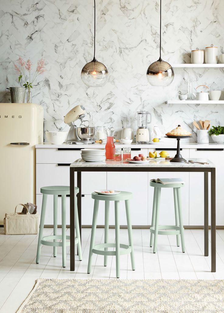 Two Ombre Mirrored Pendant lights from west elm add striking style to this beautiful kitchen. Browse a