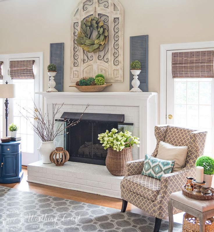 This fireplace celebrates the arrival of spring by filling the mantel and hearth with texture and a mi