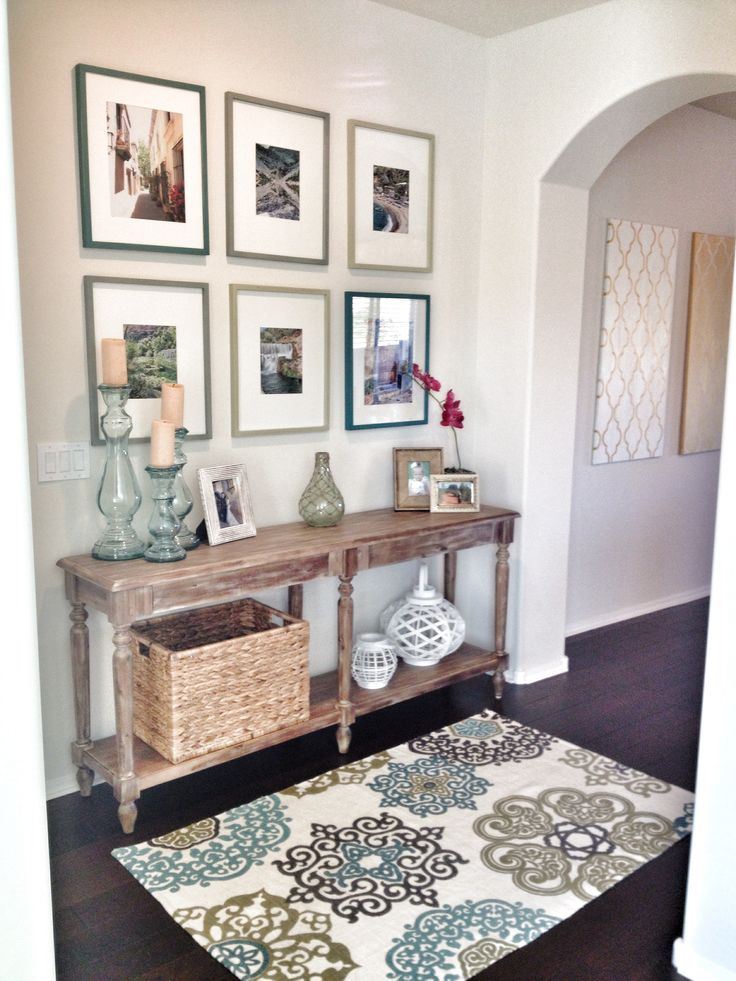 Home entry way.  World market table with tj max accessories …cheap and cute!  Photos of our travels