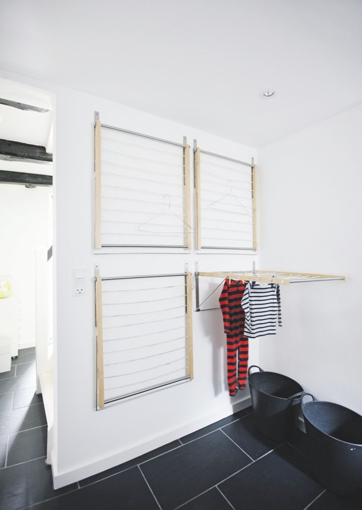 The wall-mounted drying racks from Ikea are convenient because they do not take up space when not in u