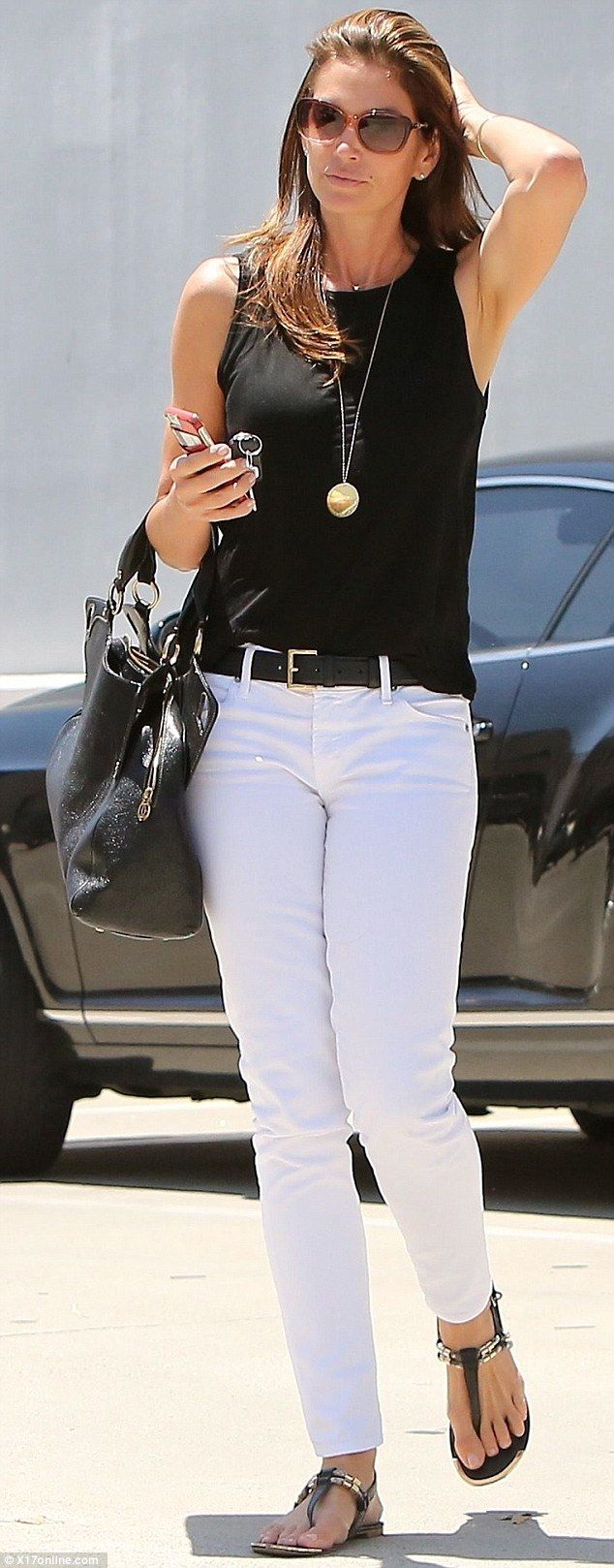 Effortlessly chic: Supermodel Cindy Crawford, 49, looks incredible in white jeans