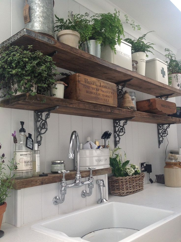 Might be cute to have some exposed shelves somewhere with iron that matches the ve