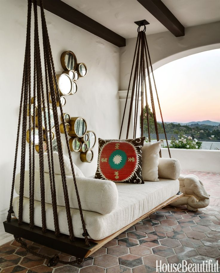 Hanging outdoor bed | love the ropes and rings | House Beautiful via Centsational