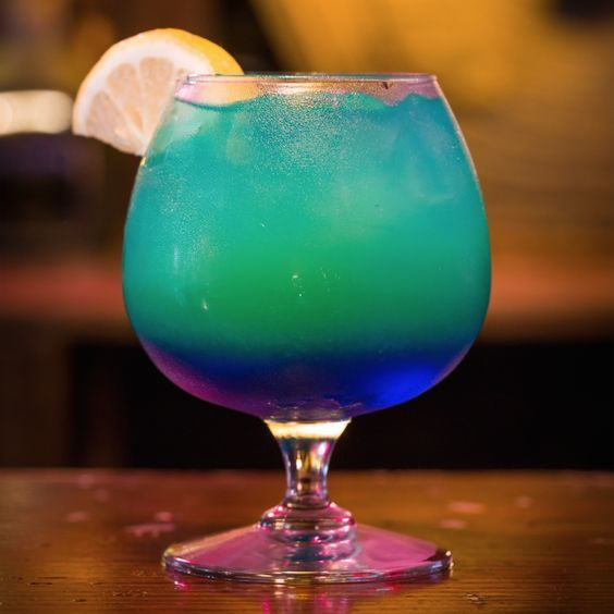 Sweet Poison: Light Rum, Coconut Rum, Blue Curacao, Pineapple Juice, Pineapple Wed