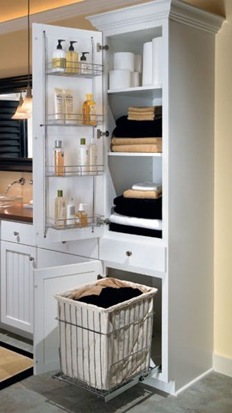 linen closet with removable hamper. probably wanna do this in the linen closet on