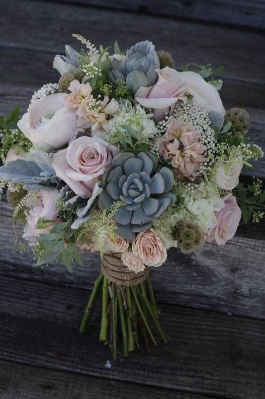 A shabby chic bridal bouquet featuring succulents, dusty pink roses and peonies fo