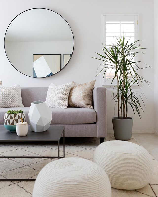 Neutral living room decor with clean lines and lots of texture // round mirror //