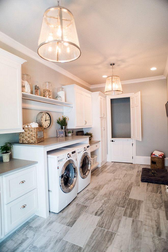 Laundry room. Laundry room flooring is porcelain tiles. Laundry room lighting is f