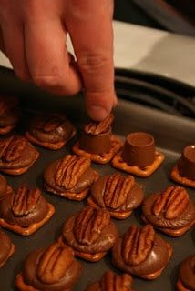 Rolo Turtles: So easy! Cover baking sheet with foil, top each pretzel with a rolo,