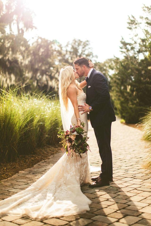 golden hour wedding kiss