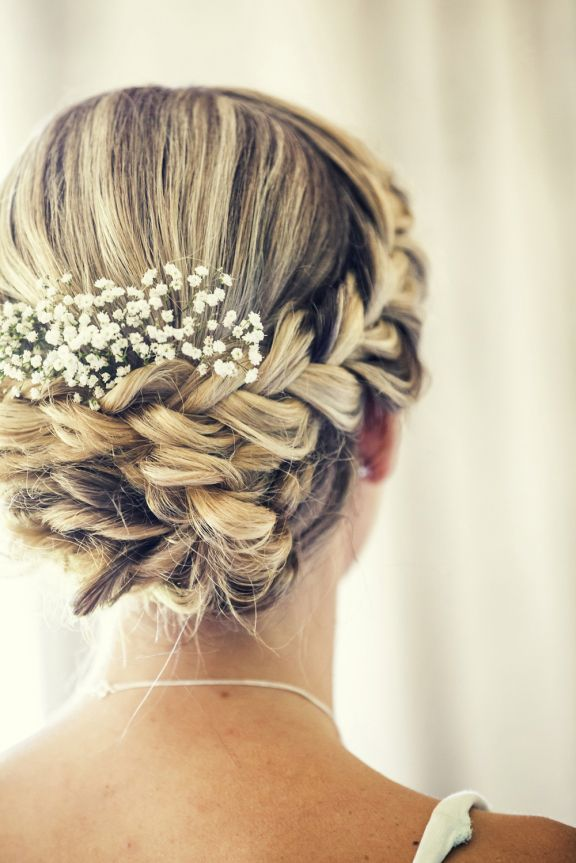 Beautiful Wedding Updo with a braid and babys breath