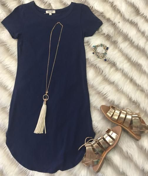 The Fun in the Sun Tunic Dress in Navy is comfy, fitted, and oh so fabulous! A great basic that can be dressed up or down! Sizing: