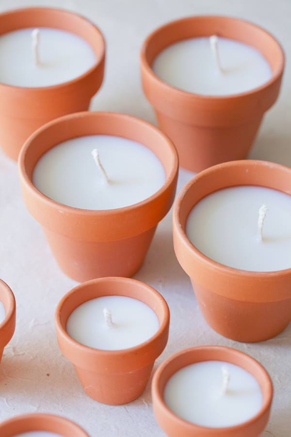 diy terracotta votive candles    Add a beautiful glow to an outdoor area with these charming DIY terracotta votives! They make